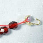 String a small bead to anchor your thread inside a calotte